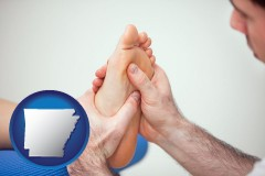 ar map icon and a podiatrist practicing reflexology on a human foot
