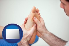 co map icon and a podiatrist practicing reflexology on a human foot