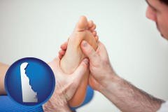 de a podiatrist practicing reflexology on a human foot