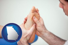 ga map icon and a podiatrist practicing reflexology on a human foot