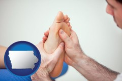 ia map icon and a podiatrist practicing reflexology on a human foot