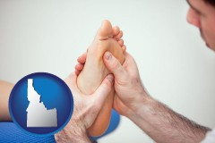 id a podiatrist practicing reflexology on a human foot
