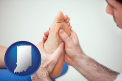 in map icon and a podiatrist practicing reflexology on a human foot