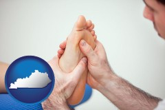 ky map icon and a podiatrist practicing reflexology on a human foot