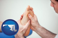 md map icon and a podiatrist practicing reflexology on a human foot