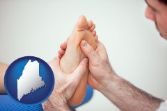 me map icon and a podiatrist practicing reflexology on a human foot