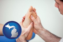 mi map icon and a podiatrist practicing reflexology on a human foot