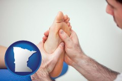 mn map icon and a podiatrist practicing reflexology on a human foot