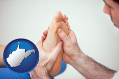 wv a podiatrist practicing reflexology on a human foot